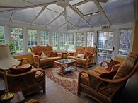 Relax in the spacious and light conservatory